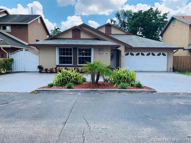 7870 NW 189th St, Hialeah, FL 33015 (MLS #A10750572) :: Grove Properties