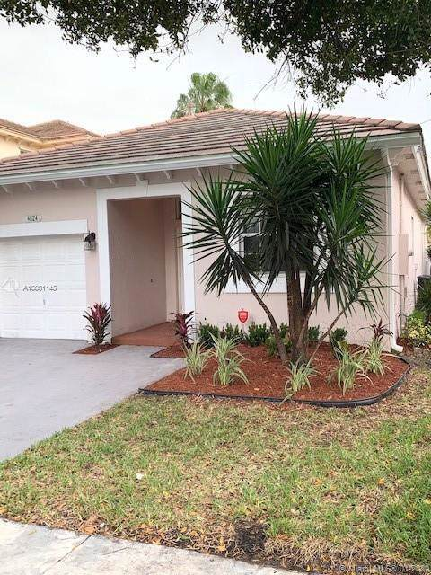 4824 NW 19th St, Coconut Creek, FL 33063 (MLS #A10801145) :: Green Realty Properties