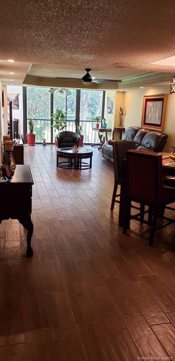 16251 Golf Club Rd #209, Weston, FL 33326 (MLS #A10801710) :: Castelli Real Estate Services