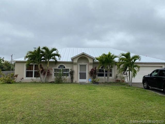 2062 SW Larchmont Ln, Port Saint Lucie, FL 34984 (MLS #A10822386) :: Berkshire Hathaway HomeServices EWM Realty