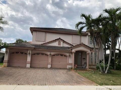 6561 Rock Creek Dr, Lake Worth, FL 33467 (MLS #A10843285) :: Grove Properties