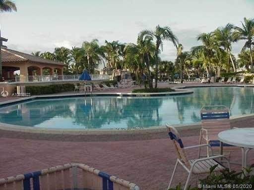 10750 NW 66th St #407, Doral, FL 33178 (MLS #A10858923) :: The Pearl Realty Group