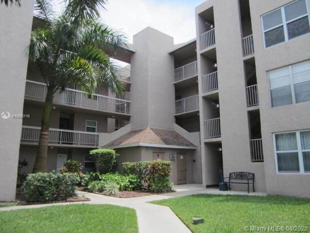 9480 Tangerine Pl #301, Davie, FL 33324 (MLS #A10880116) :: Castelli Real Estate Services