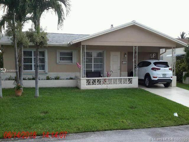 6105 NW 72nd Ave, Tamarac, FL 33321 (MLS #A10905411) :: Berkshire Hathaway HomeServices EWM Realty