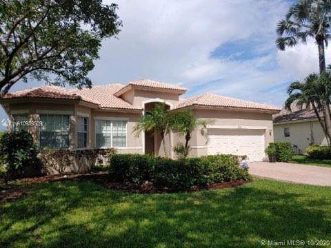5766 NW 50th Dr, Coral Springs, FL 33067 (MLS #A10939509) :: Castelli Real Estate Services