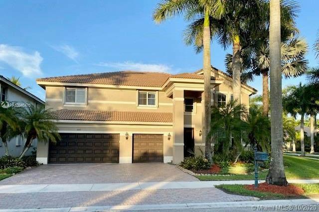 1849 Hidden Trail Ln, Weston, FL 33327 (MLS #A10940475) :: Berkshire Hathaway HomeServices EWM Realty