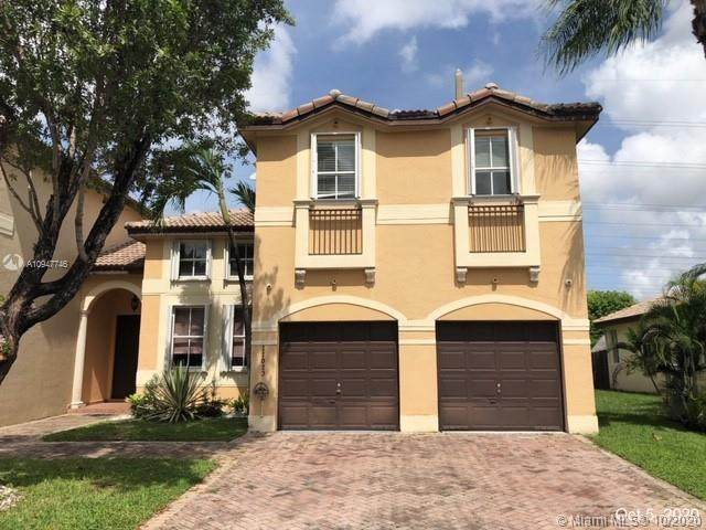 11023 NW 48th Ln, Doral, FL 33178 (MLS #A10947746) :: The Teri Arbogast Team at Keller Williams Partners SW