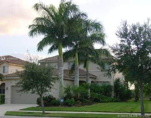 573 Live Oak Ln, Weston, FL 33327 (MLS #A10950252) :: THE BANNON GROUP at RE/MAX CONSULTANTS REALTY I