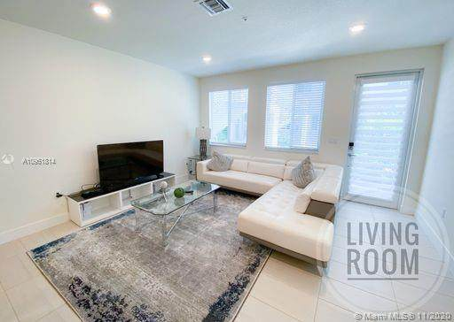 10226 NW 64th Ter #107, Doral, FL 33178 (MLS #A10961814) :: Prestige Realty Group