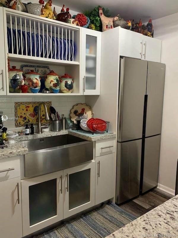 750 SW 133rd Ter 208C, Pembroke Pines, FL 33027 (MLS #A10970758) :: Berkshire Hathaway HomeServices EWM Realty