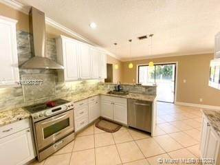 100 NW 83rd Way, Coral Springs, FL 33071 (MLS #A10987877) :: THE BANNON GROUP at RE/MAX CONSULTANTS REALTY I