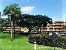 6504 Coral Lake Dr #104, Margate, FL 33063 (MLS #A10988701) :: The Teri Arbogast Team at Keller Williams Partners SW