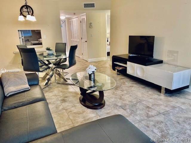 2911 N Pine Island Rd #101, Sunrise, FL 33322 (MLS #A10998337) :: Berkshire Hathaway HomeServices EWM Realty