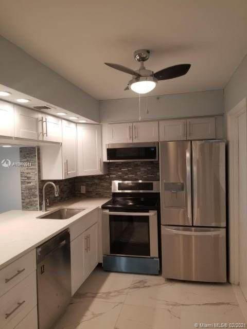2600 S Course Dr #103, Pompano Beach, FL 33069 (MLS #A10999911) :: Search Broward Real Estate Team