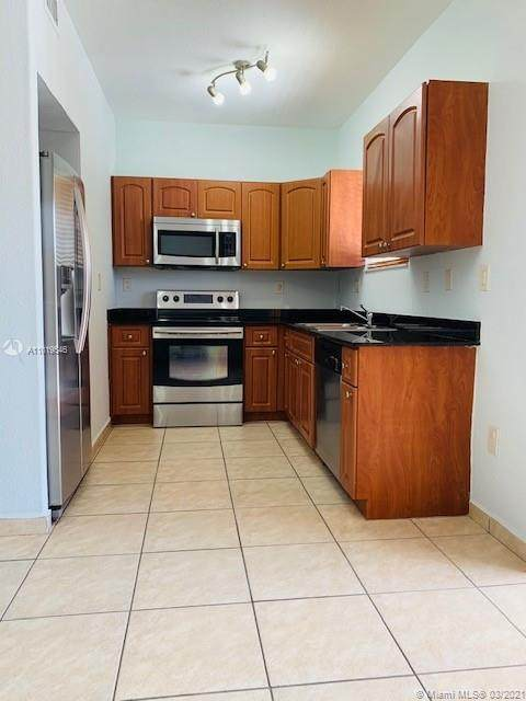 7380 NW 174th Ter #204, Hialeah, FL 33015 (MLS #A11019546) :: The Howland Group