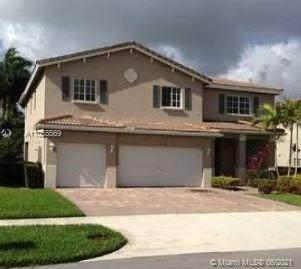 1238 NW 204th St, Miami Gardens, FL 33169 (MLS #A11055569) :: Berkshire Hathaway HomeServices EWM Realty