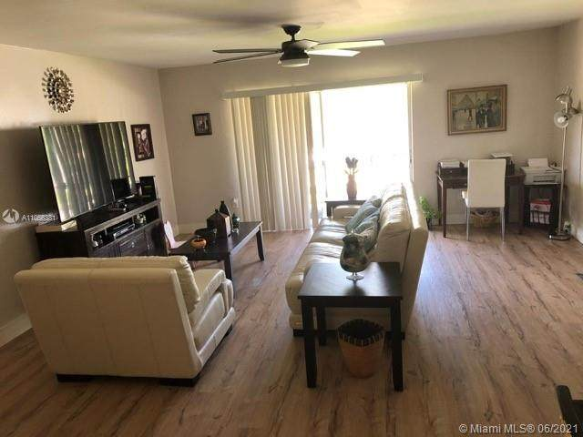 11606 NW 29th St A8, Coral Springs, FL 33065 (MLS #A11056381) :: The Teri Arbogast Team at Keller Williams Partners SW