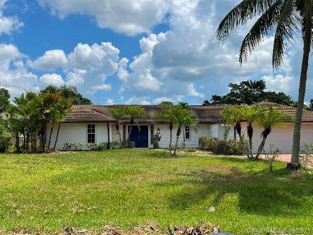 8699 SW Tropical Ave, Stuart, FL 34997 (MLS #A11094226) :: Douglas Elliman