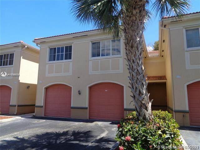 2445 Centergate Dr #203, Miramar, FL 33025 (MLS #A11099314) :: Berkshire Hathaway HomeServices EWM Realty