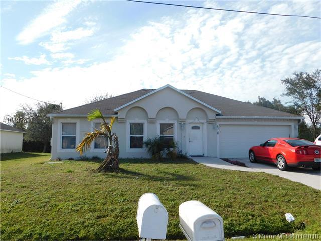 2218 SW Plymouth St, Port St. Lucie, FL 34953 (MLS #A10392897) :: The Teri Arbogast Team at Keller Williams Partners SW
