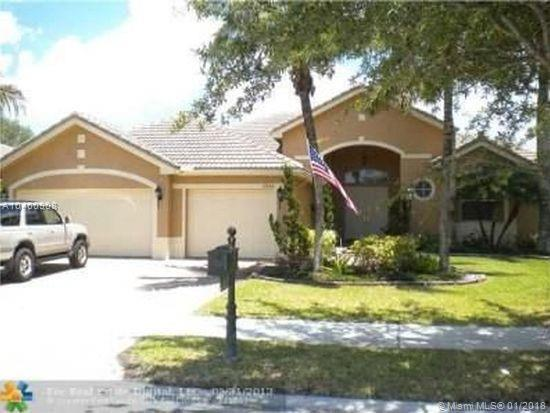 10856 NW 66th Ct, Parkland, FL 33076 (MLS #A10400908) :: The Teri Arbogast Team at Keller Williams Partners SW