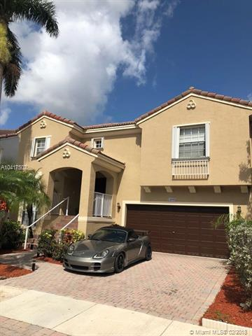 12685 NW 10 Th St, Coral Springs, FL 33071 (MLS #A10417507) :: The Teri Arbogast Team at Keller Williams Partners SW