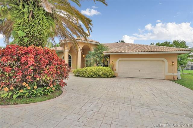 7142 NW 67th Way, Parkland, FL 33067 (MLS #A10468488) :: The Teri Arbogast Team at Keller Williams Partners SW
