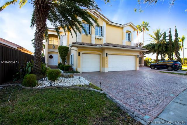 7094 NW 109th Ct, Doral, FL 33178 (MLS #A10492473) :: The Teri Arbogast Team at Keller Williams Partners SW