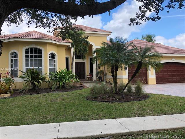 7055 NW 70th Mnr, Parkland, FL 33067 (MLS #A10493101) :: The Chenore Real Estate Group