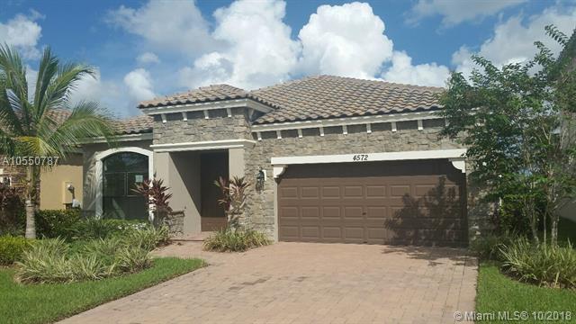 4572 Sandy Cove Ter, Lake Worth, FL 33467 (MLS #A10550787) :: Miami Villa Team