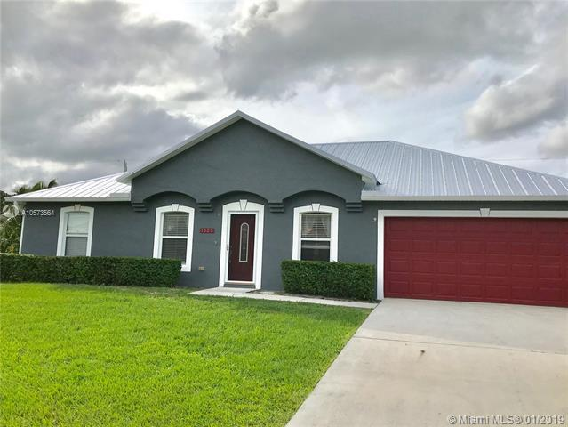 1025 SW Spataro Ave, Port St. Lucie, FL 34953 (MLS #A10573564) :: The Teri Arbogast Team at Keller Williams Partners SW