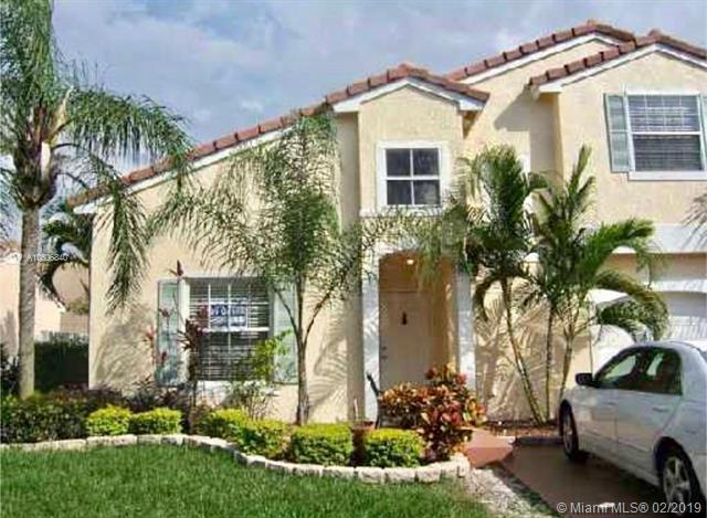 6010 NW 44th Ave, Coconut Creek, FL 33073 (MLS #A10606840) :: The Paiz Group