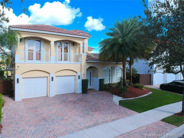 7031 NW 113th Ct, Doral, FL 33178 (MLS #A10630341) :: The Brickell Scoop