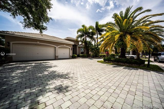 5960 NW 56th Dr, Coral Springs, FL 33067 (MLS #A10665888) :: The Paiz Group