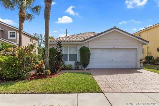 7840 NW 70th Ave, Parkland, FL 33067 (MLS #A10686404) :: The Teri Arbogast Team at Keller Williams Partners SW