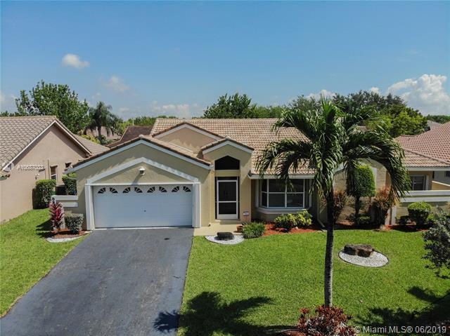 8811 NW 44th Ct, Coral Springs, FL 33065 (MLS #A10687033) :: The Brickell Scoop