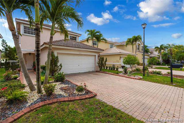 9716 NW 1st Manor, Coral Springs, FL 33071 (MLS #A10687821) :: The Kurz Team