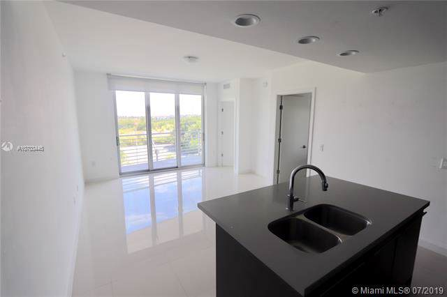7875 NW 107th Ave #317, Doral, FL 33178 (MLS #A10703445) :: Grove Properties