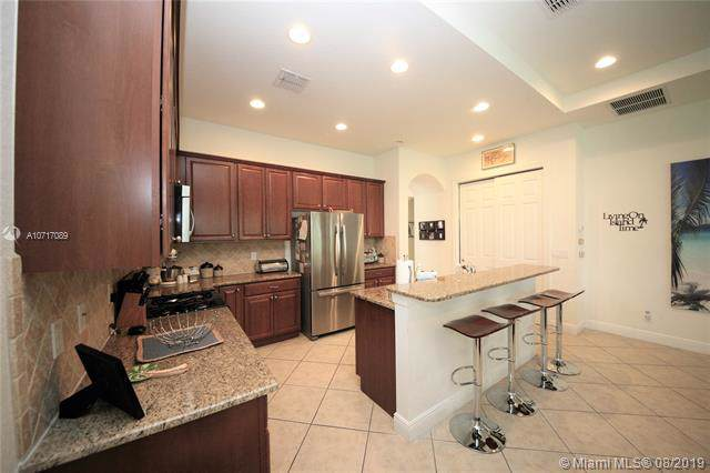 8214 NW 121st Way, Parkland, FL 33076 (MLS #A10717089) :: Grove Properties