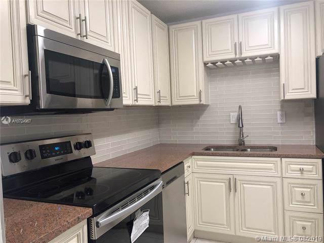 9569 SW 1st Ct #9569, Coral Springs, FL 33071 (MLS #A10724967) :: Grove Properties