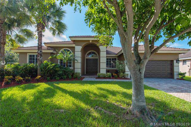 11870 NW 3 Drive, Coral Springs, FL 33071 (MLS #A10738846) :: United Realty Group