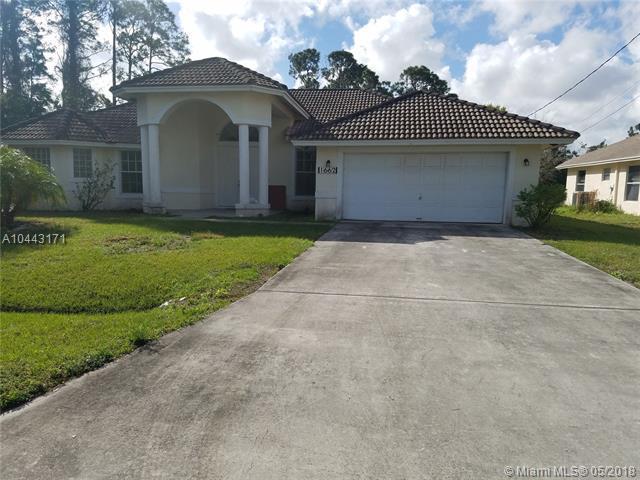 1662 SW Boykin Ave, Port St. Lucie, FL 34953 (MLS #A10443171) :: The Teri Arbogast Team at Keller Williams Partners SW