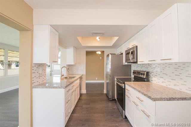 4927 NW 52nd Ct, Tamarac, FL 33319 (MLS #A10487312) :: Jamie Seneca & Associates Real Estate Team