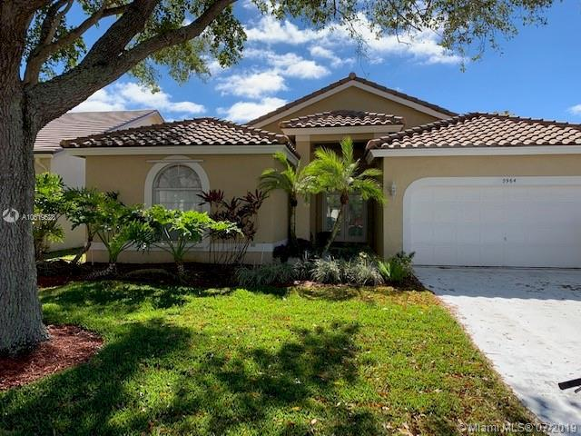 5964 NW 74th St, Parkland, FL 33067 (MLS #A10619528) :: The Teri Arbogast Team at Keller Williams Partners SW