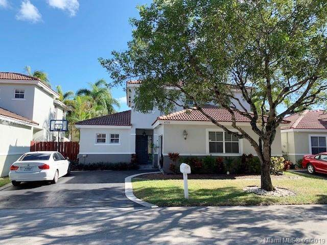 4756 NW 5th Pl, Coconut Creek, FL 33063 (MLS #A10702495) :: Grove Properties