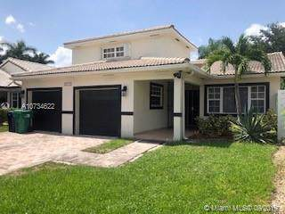 8715 NW 150th Terrace, Miami Lakes, FL 33018 (MLS #A10734622) :: Grove Properties
