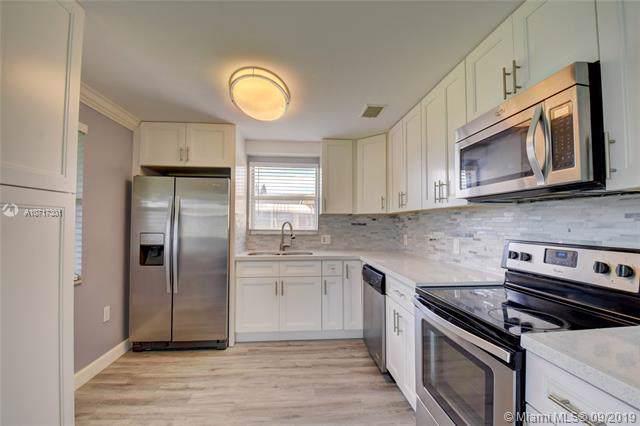 5708 NW 48th Ter, Tamarac, FL 33319 (MLS #A10717301) :: Grove Properties