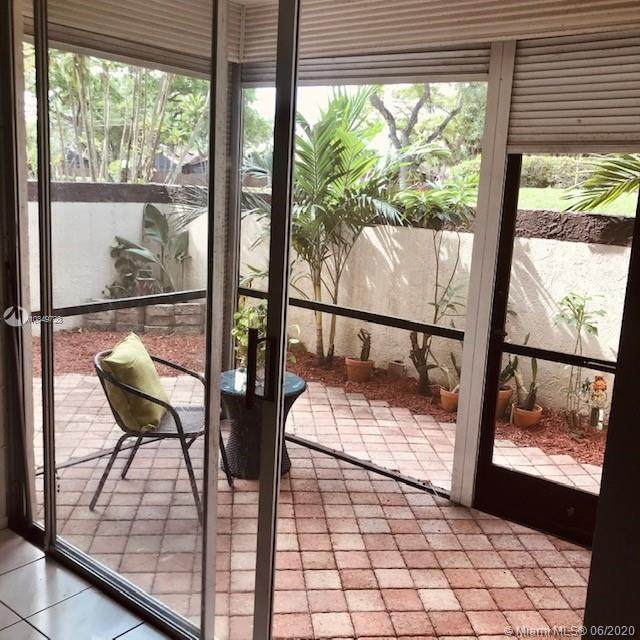 7100 NW 17th St #103, Plantation, FL 33313 (MLS #A10849728) :: The Teri Arbogast Team at Keller Williams Partners SW