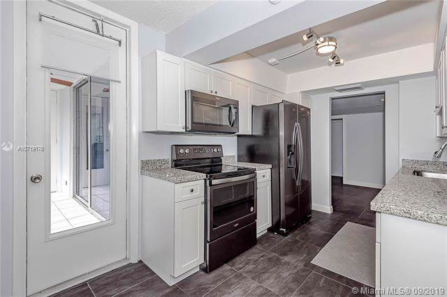100 Golden Isles Dr #806, Hallandale, FL 33009 (MLS #A10719176) :: Berkshire Hathaway HomeServices EWM Realty