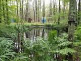 7676 Holton Duck Lake Road - Photo 42